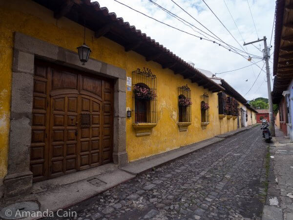 A cobblestone street and colonial houses in Antigua.