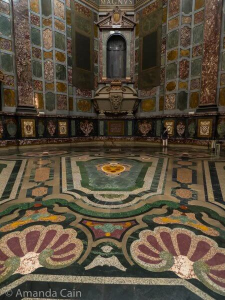 "Close up of the elaborate floor decorations in the Medici Chapel. There's also supposed to be a statue in the spot above the ""casket"" but it's been taken away for restoration."