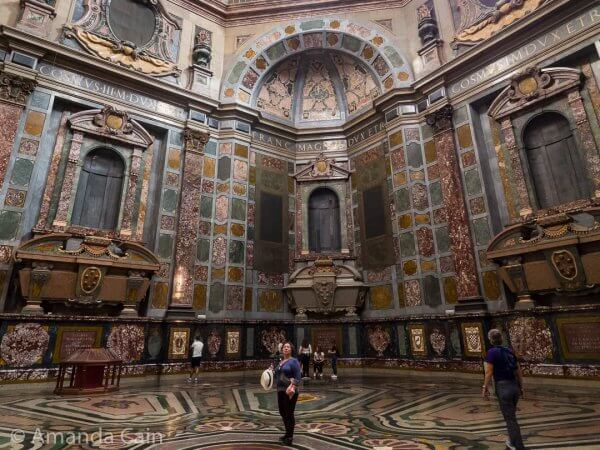 "The ridiculously extravagant Medici Chapel. Each ruler also has their statue (covered in gold) normally in the spot above the ""casket"", but they've been taken away for restoration."