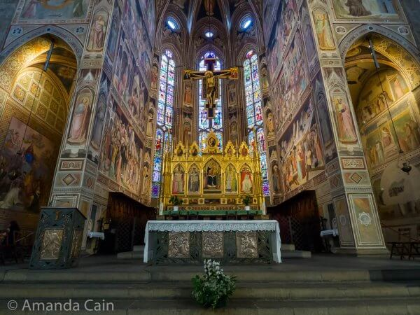 The inside of Santa Croce is covered in paintings. Very different to the inside of the Duomo.