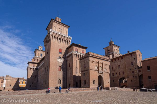 Ferrara's Castle, built in the 1300s. It was originally one of the gates into the city, but was expanded into a proper castle after a big riot by the people that scared the rulers of the city.